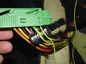 Like before at the radio harness plug, locate the larger yellow/green wire and use the larger connector to splice the new wire to it as shown here.