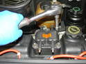 Remove the four 10mm bolts securing the old coil to the valve cover and simply lift it off.