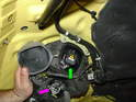 On cars with Xenon headlamps, pull the two rubber covers off the back of the headlamp assembly.