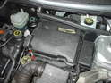(R50 Cooper) Shown here is the battery box for the R50 Cooper which is located under the hood.