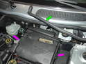 (R50 Cooper) Pull the weather-stripping off the top edge of the battery box cover as shown here (green arrow).