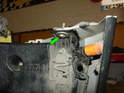 Now loosen and remove both of the 10mm bolts securing the side of the bumper cover to the frame underneath (green arrow).