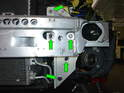 As above, remove the four 13mm nuts (green arrows) and the 13mm bolt securing the driver's side of the bumper carrier to the front of the car.