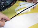 After the vinyl stripes have set and you have removed any remaining pockets of air, apply the trim edging.
