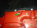 Under the inner door handle (removed earlier) is the upper mounting bolt for the front regulator rail (green arrow).