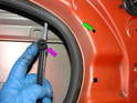 Don't forget to remove the retaining clip (purple arrow) from the mounting hole in the door (green arrow).