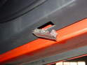 Look on the bottom edge of the door panel and pry out the door light from the rear.