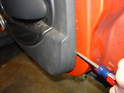 Use a large flat blade screwdriver around the sides and lower edges of the door panel to remove it from the door.