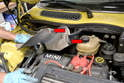 Next you will need to remove the heat shield that goes between the exhaust manifold and the starter.