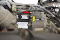 Use a 13mm and 10mm socket and remove the wiring to the starter (red and yellow arrows).