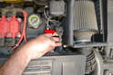 To remove the pre-cat sensor open the hood and locate the wiring connection on the left side of the motor (red arrow).