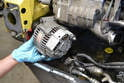 Disconnect the wiring for the alternator and remove it; please see our article on alternator removal if you need additional help.