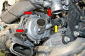 Still using the pliers remove the smaller hose on the rear of the pump (yellow arrow) and then use a 13mm socket and or wrench and remove the three bolts (red arrows) holding the supercharger to the water pump.