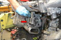 Remove the diverter tube form the supercharger by pushing down on the red circle and lifting it up (red arrow).