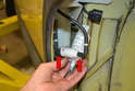 With the pump out you can carefully pull the two lines out from the pump (red arrows).
