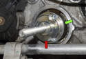 Install MINI tool 11 9 601 (red arrow) onto the crankshaft (green arrow) with the supplied fasteners.