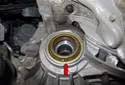 Install the seal until it bottoms out (red arrow).