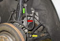 Front sway bar links: The front sway bar link (red arrow) connects the strut (green arrow) to the sway bar (yellow arrow).