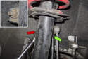 Front sway bar links: Working at the strut, loosen the 16mm end link nut (red arrow) while counter-holding the ball joint with a 16mm wrench (green arrow).