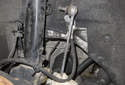 Front sway bar links: Next, remove the stabilizer link from the vehicle.