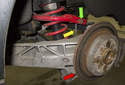 Rear sway bar links: The rear sway bar link (yellow arrow) connects the rear swing arm (red arrow) to the sway bar (green arrow).