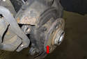 With the rotor removed, you now have access to the wheel hub and bearing (red arrow).