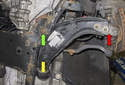The front control arms have three attachment points, with bushings that anchor the rear control arm to the subframe (yellow arrow).
