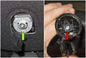 When installing, start with the mirror 90° off center to align the spring (red arrow) with the mount (green arrow).