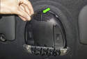 Working at the end of the switch trim, pull it down (green arrow) to detach it.