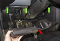 Lower and remove the trim panel (red arrow) from the vehicle.