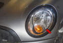 The headlight on MINI R56 models in now mounted to the fender (red arrow), instead of on the hood like with generation 1 models.