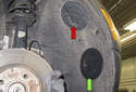 To access the headlight bulb (red arrow) or the fog light (green arrow), there are access doors in the wheel well.