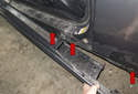 Release the sill trim slowly down its entire length, disengaging each clip.