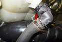 Coolant leaking down the left side of the engine can be from the thermostat, coolant hoses or from the oil filter stand / housing, auxiliary coolant pump or reservoir.