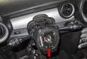 Release the steering wheel position adjuster.