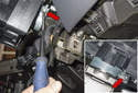 Working below the steering column and on the right side, loosen the T30 Torx fastener (red arrows) for the steering column switch assembly.