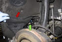 Front sensor: Fold the wheel well liner (red arrow) away from the wheel well to expose the sensor connector (green arrow).