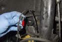 Front sensor: Unclip the brake pad wear sensor wiring from the wheel speed sensor (red arrow).