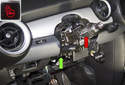 The steering column (red arrow) was originally equipped with a steering lock (green arrow).