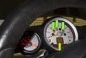 A faulty wheel speed sensor can set multiple brake warning lights (green arrows).