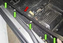 Release the sill trim slowly down its entire length (red arrow), disengaging each clip.