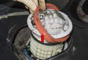 Slowly lift the fuel unit up slightly out of the tank enough to remove the sealing O-ring.