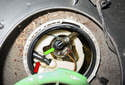 Working at the top of the fuel pump module, remove the fuel siphon hose and pressure line.