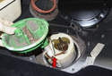 Lift the fuel pump module up to remove it (red arrow).