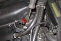 Using a flathead screwdriver, loosen the mass airflow sensor duct clamp (red arrow).