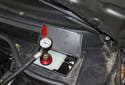 Pressurize the brake system to a maximum of 10 psi (red arrow).