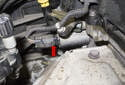Exhaust: Release the tab (red arrow) and pull it straight off the solenoid.
