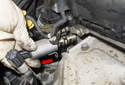 Exhaust: Pull the solenoid out of the cylinder head (red arrow).
