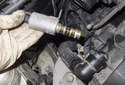 Intake: Pull the solenoid out of the cylinder head.