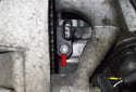 Next, completely loosen the crankshaft sensor T25 Torx mounting fastener (red arrow).